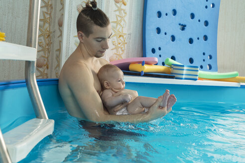 Baby swimming, father and son in swimming pool - VGF00252