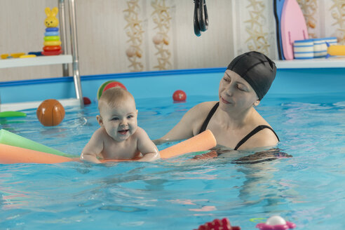 Baby swimming, mother with daughter in swimming pool - VGF00267