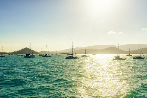 Australia, Queensland, Airlie Beach, landscape with boats at sunset - KIJF02489