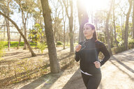 Young woman jogging in park - WPEF01431