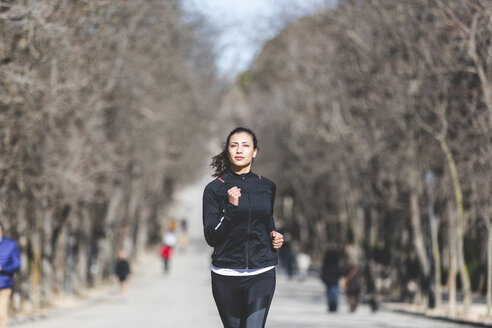 Young woman jogging in park - WPEF01434