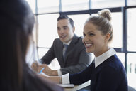 Smiling businesswoman in meeting - HEROF32724