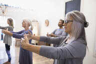 Serene women practicing tai chi in exercise class - HEROF32837