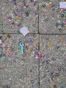 Colourful rubber rings on pavement - JMF00438