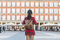 Spain, Madrid, Plaza Mayor, back view of woman with backpack in the city - WPEF01454