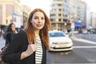 Portrait of redheaded young woman with nose piercing in the city - WPEF01457
