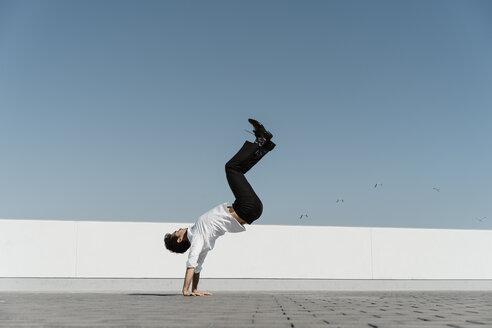 Artist practising on roof terrace - AFVF02664