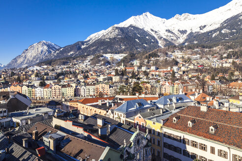 Austria, Tyrol, Innsbruck, Panoramic views of the city with snow-capped Alps in background - FLMF00165