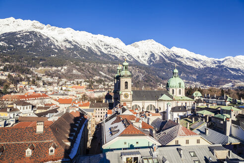 Austria, Tyrol, Innsbruck, Panoramic views of the city with snow-capped Alps in background - FLMF00171