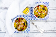 Paella with rice, bell pepper, tomato, artichoke, pea, black olive, curcuma and shrimps - LVF07937