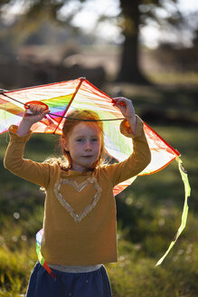 Portrait of redheaded girl holding a kite - GAF00131