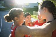 Female high school track and field athletes huddling - HEROF33213