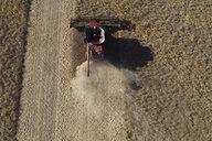 Aerial view combine harvester harvesting sunny crop - HEROF33339