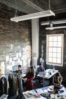 Fashion designers working in loft office - HEROF33531