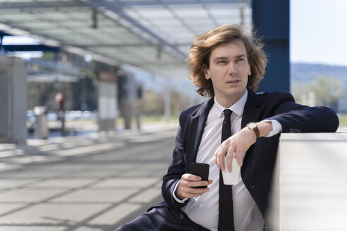 Italy, Florence, young businessman outdoor - FMOF00505