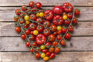 Various sorts of tomatoes building heart on wood - STBF00284