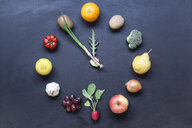 Fruits and vegetables buliding clock on dark ground - STBF00287