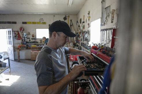 Man looking in toolbox in workshop - HEROF33600