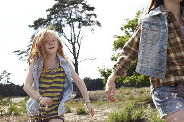 Two girls running through dune landscape - AMEF00056