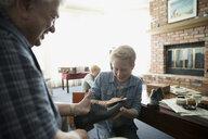 Grandfather teaching grandson how to polish shoes - HEROF33990