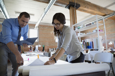 Designers reviewing plans in office - HEROF34239