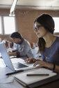 Designer using laptop in office - HEROF34251