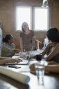 Designer leading meeting in office - HEROF34296