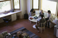 Couples talking around cabin table - HEROF34365