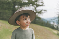 Portrait of a little boy, wearing his mother's hat - CMSF00013
