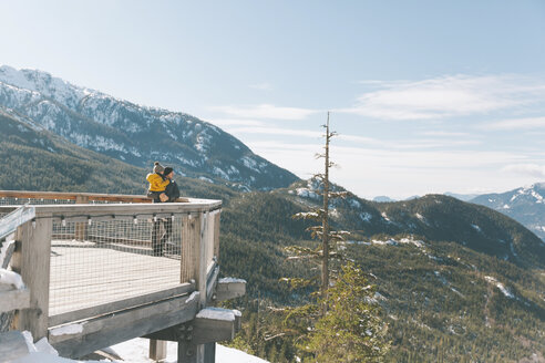 Father holding his son on an observation deck, looking over Squamish, Canada - CMSF00028