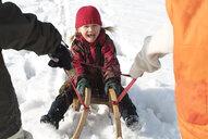 Portrait of little girl on sledge - WWF04916