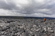 USA, Hawaii, Big Island, Volcanoes National Park, photographer on lava field along Chain of Craters Road - FOF10537