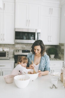 Mother and daughter making a cake together - CMSF00037