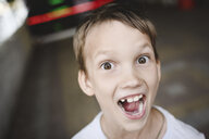 Portrait of excited boy screaming - EYAF00119