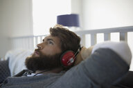 Man with headphones relaxing listening to music - HEROF34487