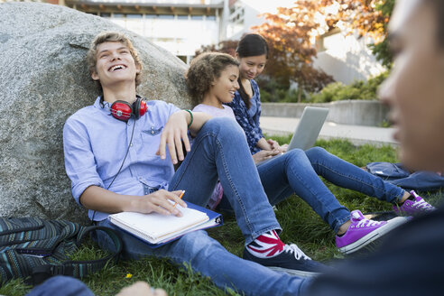 Laughing high school student studying with friends campus - HEROF34535
