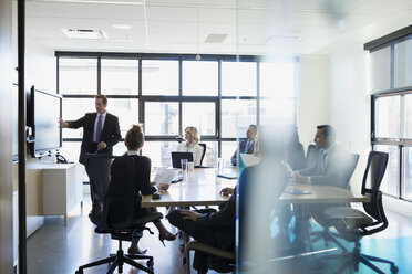 Businessman leading meeting in conference room - HEROF35022