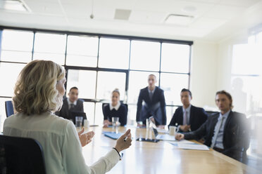 Businesswoman leading meeting in conference room - HEROF35028