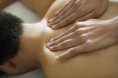Man receiving massage - HOXF04346