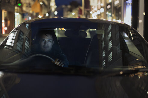 Portrait man driving car at night - HOXF04349