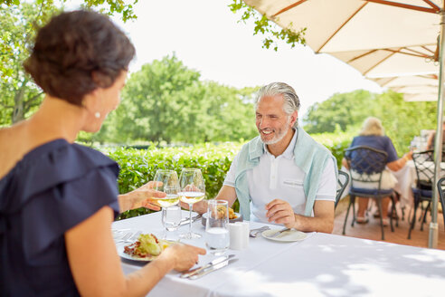 Mature couple dining at patio table - CAIF23156