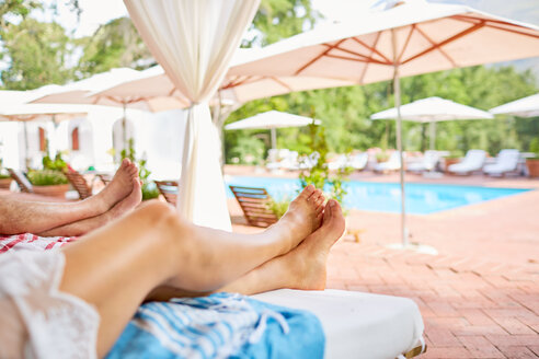 Couple relaxing at resort poolside - CAIF23165