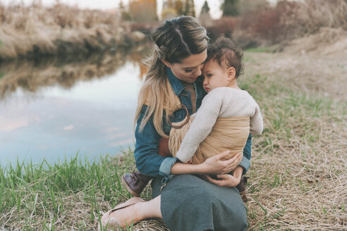 Mother holding her little daughter affectionately in nature - CMSF00058