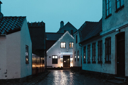 Denmark, Dragor, lighted house in the old town at twilight - AFVF02722