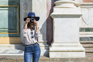 Italy, Florence, young tourist taking photograph with camera - MGIF00331