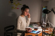 Woman working late at home - CUF49941