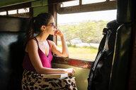 Woman on local train, Galle, South Coast, Sri Lanka - CUF49977