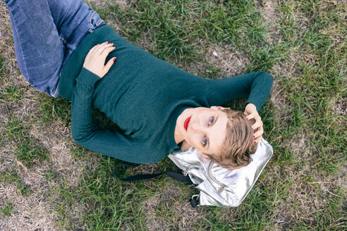 Woman lying on grass - CUF49986