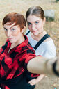 Best friends taking selfie - CUF50040