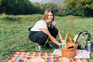 Woman having picnic, Rezzago, Lombardy, Italy - CUF50058